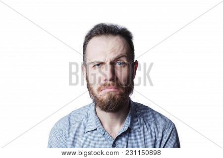 Face Of An Angry And Furious Male On A White Background.