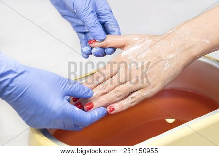 Process Paraffin Treatment Of Female Hands In Beauty Salon .