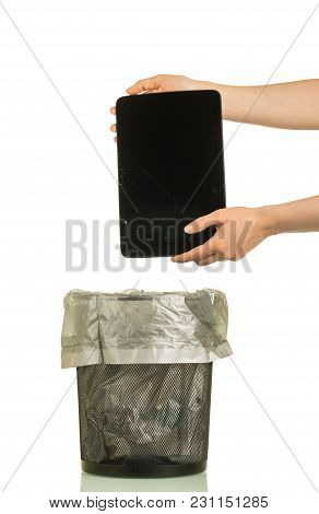 Female Hands Throwing Broken Device Into Trash Can, Isolated On White Background