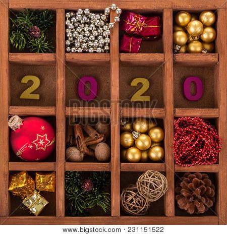 Christmas Decorations, Gifts, Spices And Bumps, Inscription 2020, In Wooden Box With Cells. Backgrou