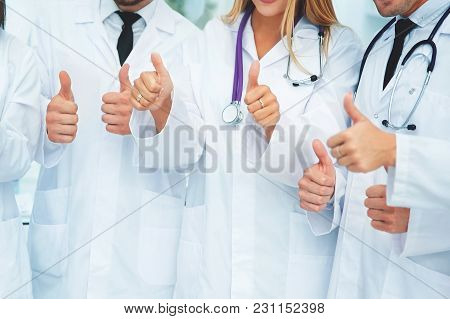 Successful Team Of Doctors And Other Medical Workers Against The Background Of The Conference Hall