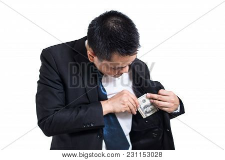 A Businessman Wear Black Suit Putting Money In His Pocket Isolated On White Background. Businessman