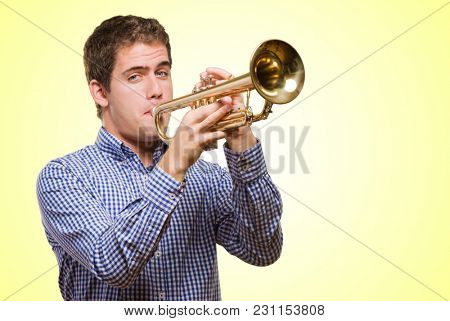 Cute Man Blowing Trumpet against a yellow background