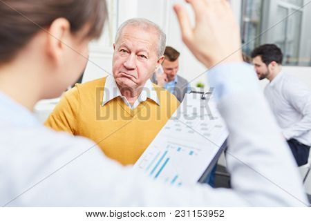Senior consulting businessman stares with scepticism