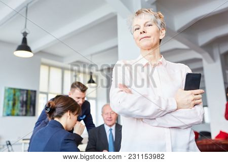 Senior woman as executive chief or boss in the office