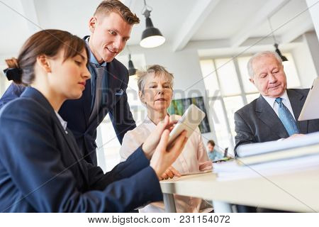 Business people in a meeting with senior managers