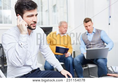 Businessman on business call with wireless phone