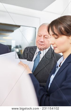 Senior business man and colleague in a meeting planning strategic analysis