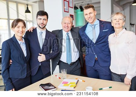 Successful business team with manager standing proud as a group