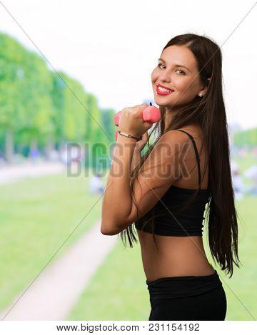 Beautiful Young  Woman Exercising at a park