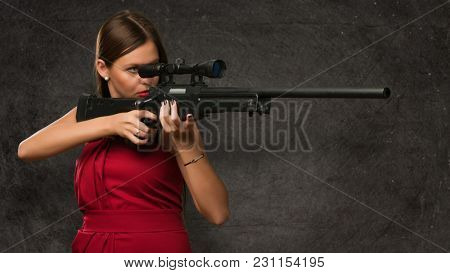 Girl Aiming With Gun against a grunge background