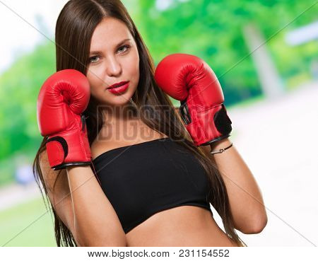 Female Model Wearing Boxing Gloves, outdoor