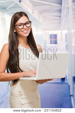 Young Woman Holding Laptop, indoor