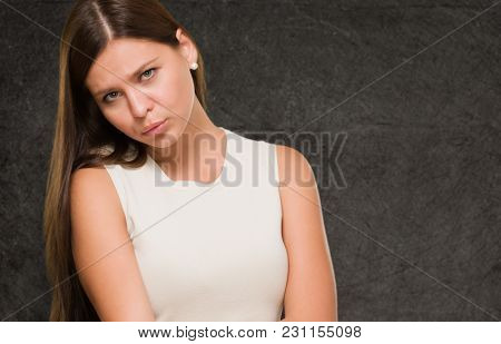 Young Sad Woman against a grunge background