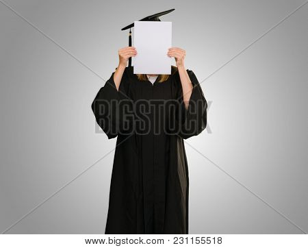 Graduate Woman Holding Placard On Grey Background