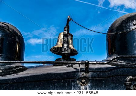Vintage Steam Engine Locomotive Brass Bell On A Sunny Blue Sky