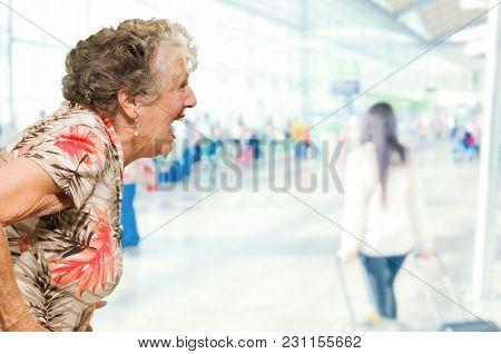 Portrait Of Shocked Senior Woman, Indoors
