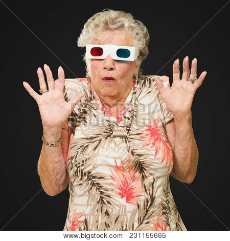 Afraid Senior Woman Watching 3d Movie On Black Background