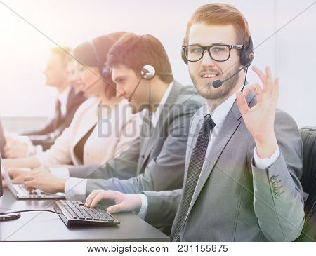 customer service representative with headset showing sign
