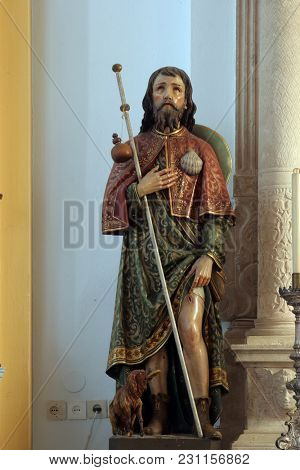 SMOKVICA, CROATIA - MARCH 21: Saint Roch, statue on the Our Lady of Mount Carmel altar in the Church of Blessed Virgin of Purification in Smokvica, Korcula island, Croatia, on March 21, 2017.