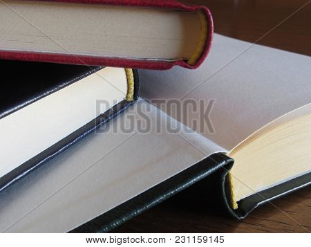 Second Hand Books With Blank Pages On A Wooden Table