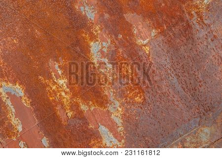 Surface Of Rusty Iron With Remnants Of Old Paint, Grunge Metal Surface, Texture Background