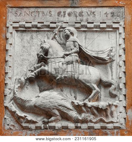 Saint George Fights The Evil Dragon Old Relief On A Venice Wall, Made In 1496