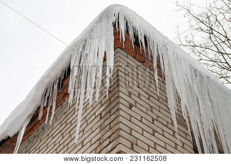 Huge Dangerous Icicles Hanging From The Roof