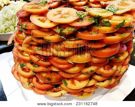 Sliced Tomatoes With Parsley. Sliced Tomatoes. Tomatoes Cut Into Slices For Salad