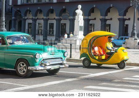Havana, Cuba - January 16, 2017: Old Car And Cocotaxi In Old Havana. Coco Taxi Is An Auto Rickshaw T