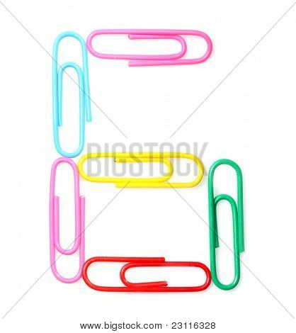 Colorful number six from paperclips. One part of funny school or office alphabet.