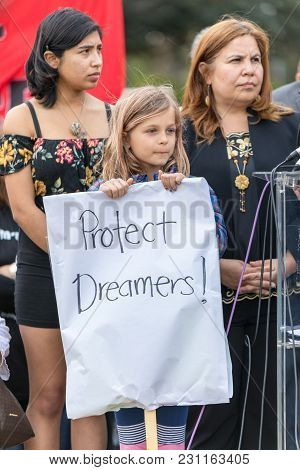 Beverly Hills, California - March 12, 2018: A Young Child Holds A Sign That Reads,