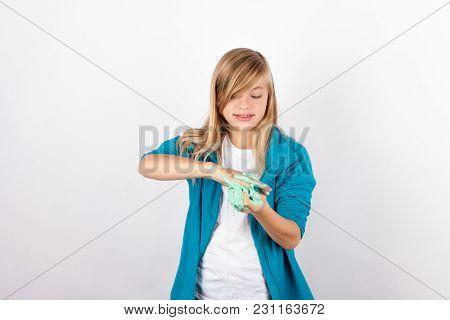 Cute Girl Playing With Slime Looks Like Gunk