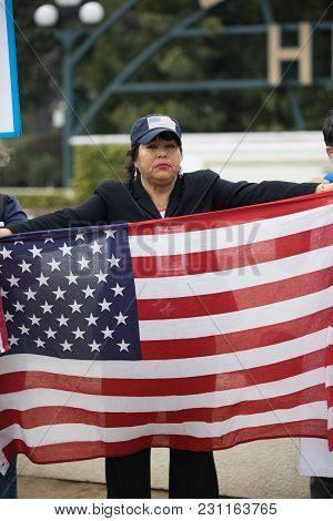 Beverly Hills, California - March 12, 2018: A Protester Holds The Usa Flag At The Defend Dreamers Ra