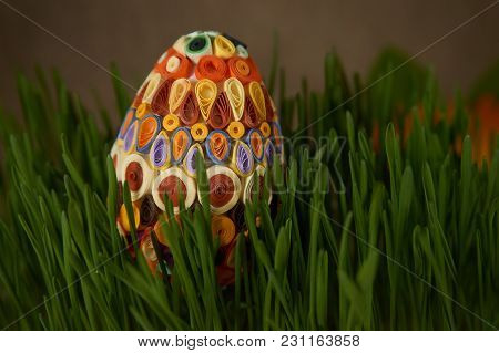Easter Craft Ideas. The Easter Egg Decorated With Multicolored Paper,  Placed Between Frech Green Wh