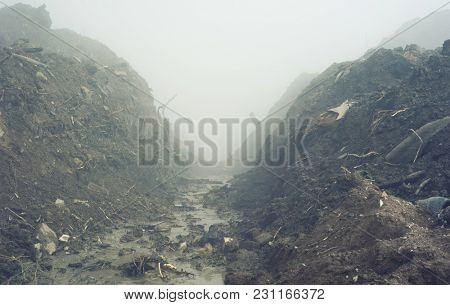 Dirty landscape with fog over land