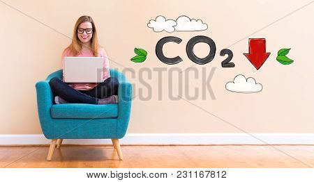Reduce Co2 With Young Woman Using Her Laptop In A Chair