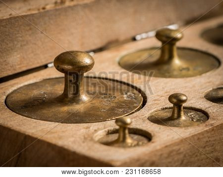 Old Brass Weights For A Kitchen Scale In A Wooden Box
