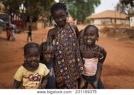 Nhacra, Republic Of Guinea-bissau - January 28, 2018: Portrait Of A Smiling Group Of Children In The