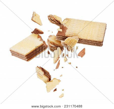 Waffles Broken Into Pieces, Isolated On A White Background