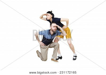 Dancers Are Looking For Something. Boogie Or Lindy Hop In A Studio Background. Dance For Rock-n-roll