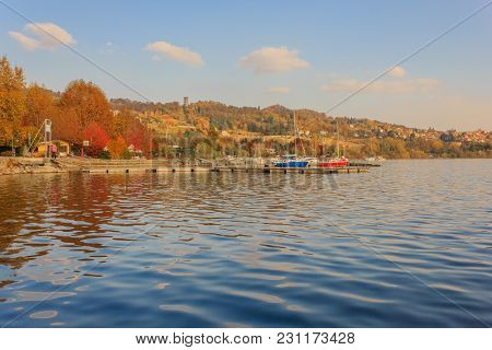 View Of The Lake Of Viverone In Italy With The Dock For Mooring Boats  / Lake Viverone Is The Third