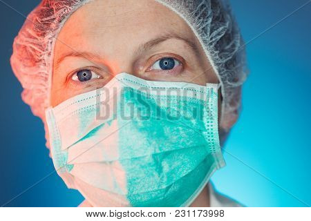 Headshot Portrait Of Female Healthcare Professional In Uniform Looking At Camera. Medicine And Healt