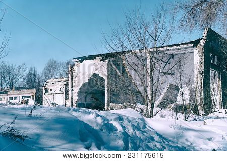 Ruins Of An Old Building Standing In The Snow. Winter Season