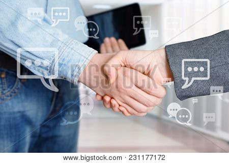 Employees Shake Hands As The Result Of An Agreement.