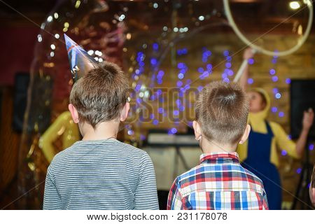 Two Boys Watch A Holiday Show Ar The Birthday Celebration, Children Entertainment