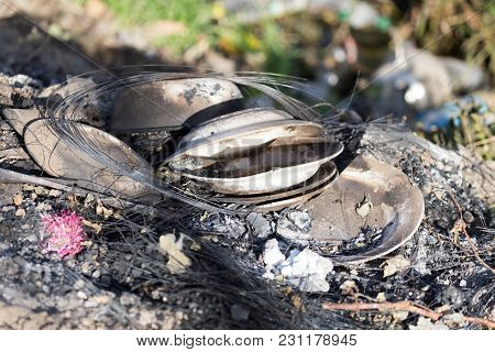Burnt Dish On Nature As Garbage . In The Park In Nature