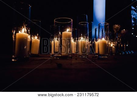 The Vases With Candles Stand For Wedding Ceremony