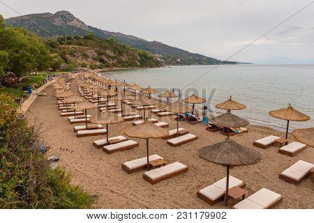Zakynthos, Greece - September 28, 2017: Umbrellas And Sun Beds On Porto Zorro Beach In The Vasilikos
