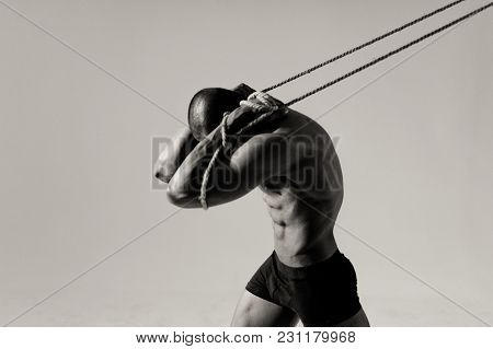 Man With A Beautiful Body Posing On The Ropes